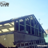 Czeladź - podniesienie dachu z konstrukcji drewnianej na murach